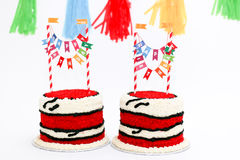 Twin birthday cakes with banners Royalty Free Stock Image
