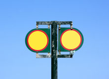 Twin Blank Yellow And Red Cautionary Signs. Twin blank red and yellow cautionary signs with copyspace an blue sky background royalty free stock photo