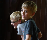 Twin Boys Laughing. The twin brothers are enjoying a summers day. A stray beam of light catches their faces Stock Images