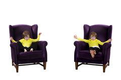 Twin boys sitting on armchairs happy angry Stock Photography