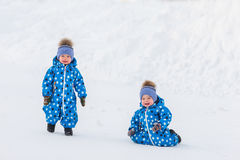 Twin boys walking in the Park in winter, learn to take the first steps Stock Photos