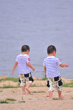 Twin brothers. Walking on the beach Stock Photography