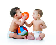 Twin brothers with balls Stock Images