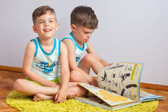 Twin brothers with book Royalty Free Stock Photography