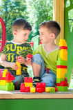 Twin brothers build towers Royalty Free Stock Image