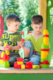 Twin brothers build towers Stock Images