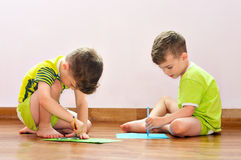 Twin brothers draw pictures Stock Photos