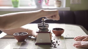 Twin brothers helping her mother to grind coffee. In the kitchen in the morning stock video