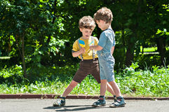 Twin brothers play in the park Royalty Free Stock Image