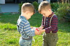 Twin brothers play with toy car Stock Images