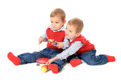 Twin brothers playing Stock Photos