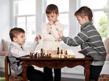 Twin brothers playing chess game Stock Image