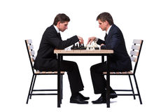 The twin brothers playing chess isolated on white Royalty Free Stock Images