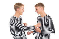 Twin brothers playing a joke Royalty Free Stock Images