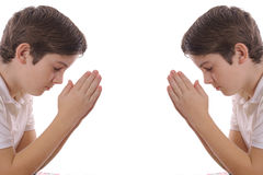 Twin brothers praying. Isolated on white Royalty Free Stock Photography