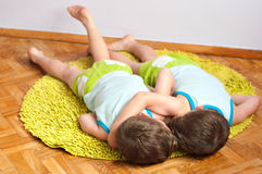 Twin brothers rest after struggle Stock Image