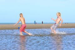 Twin brothers running on the beach Royalty Free Stock Photo