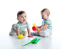 Twin brothers with shovel and rake Stock Images