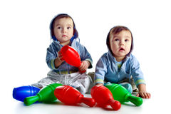 Twin brothers with skittles. Isolated on a white background Royalty Free Stock Photos