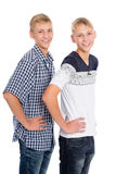 Twin brothers standing on white Royalty Free Stock Images