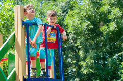 Twin brothers stend on the porch of the playground Royalty Free Stock Photos