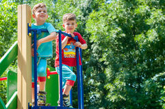 Twin brothers stend on the porch of the playground Stock Image