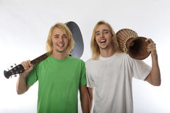 Twin brothers with their guitar and drum Stock Image