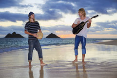 Twin brothers with their guitar and drum Royalty Free Stock Photos