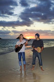 Twin brothers with their guitar and drum Royalty Free Stock Photo
