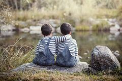 Twin brothers. Hugging each other Stock Photo