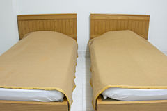 Twin brown bed and blanket on white mattress at ho Stock Image