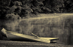 Twin Canoes on Foggy Lake Royalty Free Stock Photo
