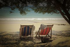 The twin chair at the beach stock images