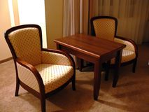 Twin Chairs. Furniture set consisting a small wooden table and two chairs Royalty Free Stock Photos
