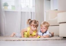 Twin children play Stock Image