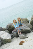 Twin children playing on rocks at the beach. Shot of twin children playing on rocks at the beach Stock Photos