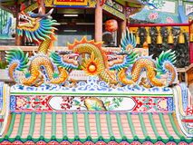 Twin china dragon and big dragon statue gold color on the roof royalty free stock photography