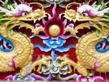 Twin chinese dragon. Stucco, mirroring carved Stock Photos