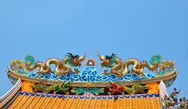 Twin dargon scluptures on temple roof. Royalty Free Stock Photos