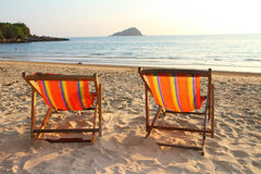 Twin deck chairs on the beach Stock Photo
