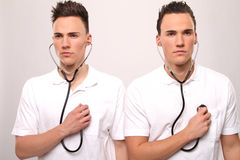 Twin doctors Stock Photo