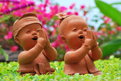 Twin doll. For welcome in the garden royalty free stock photography