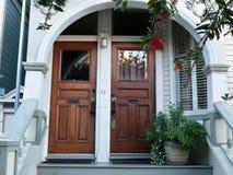 Twin doors. Two wooden twin doors in Victorian building Royalty Free Stock Image