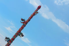 Twin Dragon on red pole on blue background. Royalty Free Stock Photo