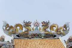 Twin dragon statue on the roof Stock Photography