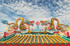 Twin Dragon on the temple roof with sky background Stock Images