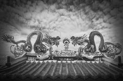 Twin Dragon on the temple roof with sky background Royalty Free Stock Photos