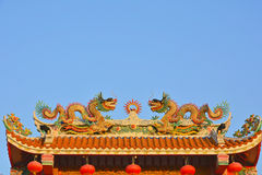 Twin dragons on the Chinese temple roof. Stock Photo