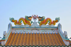 Twin dragons on the Chinese temple roof. Royalty Free Stock Photo