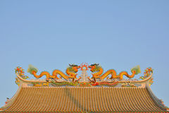 Twin dragons on the Chinese temple roof. Stock Photography